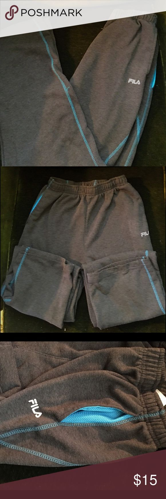 🌹grey with turquoise trimming fila sweat pants 🌹 🎉flia sweat pants are grey with with turquoise. Trimming and two side pockets 💕elastic waist band 💕nice fitting 💕comfortable. Good condition had been cleaned in fragrance free detergent Fila Pants Track Pants & Joggers
