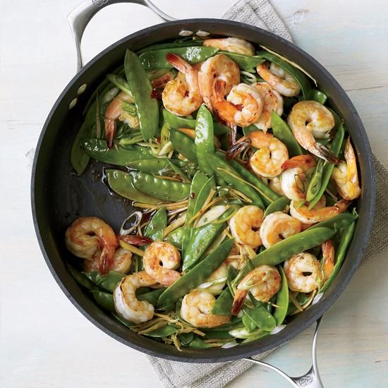 Gingered Stir-Fry with Shrimp and Snow Peas | Large nonstick skillets that can create a sear are ideal for stir-fries. For this recipe, F&W's Grace Parisi creates layers of flavor with Chinese chile-garlic sauce and matchsticks of fresh ginger.