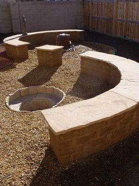 Ying yang variation with banco, firepit and water feature