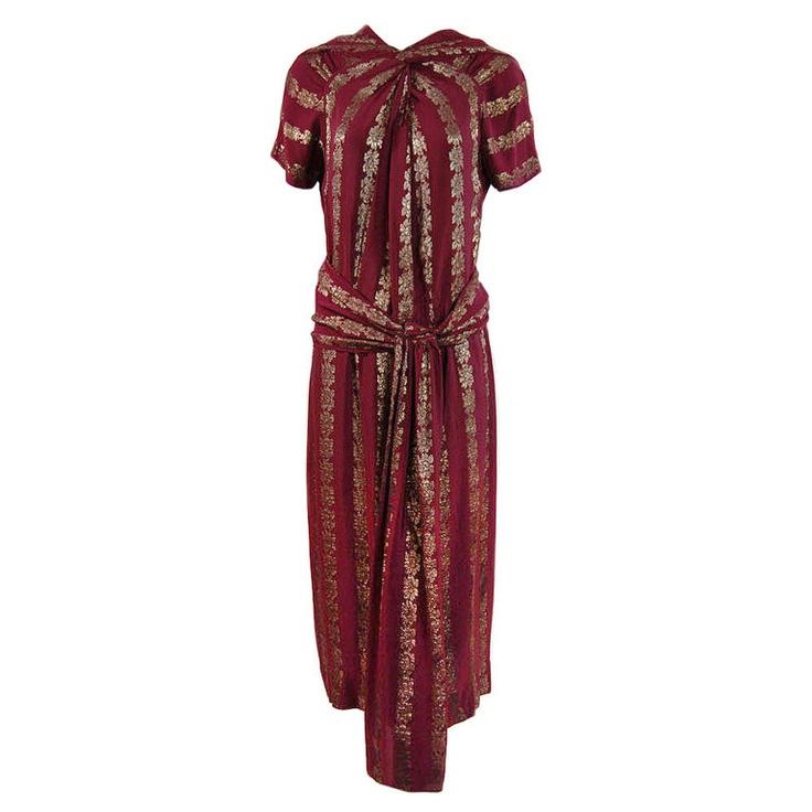 "Dress: 1930's, draped silk shot with lamé threading.     Label: ""An Original Design, Registered by a Member of the Fashion Gild Originator's Guild"""