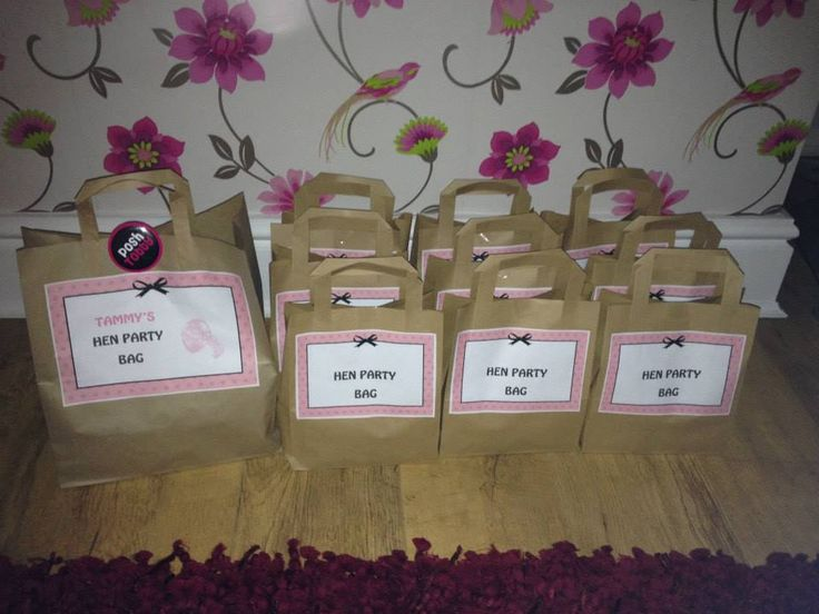 Hen do bags that I made! Made with cheap lunch bags, printouts, and fillers such as chocolate, tissues, glow sticks, whistles, alcohol shots, badges, sweets, straws and other bits