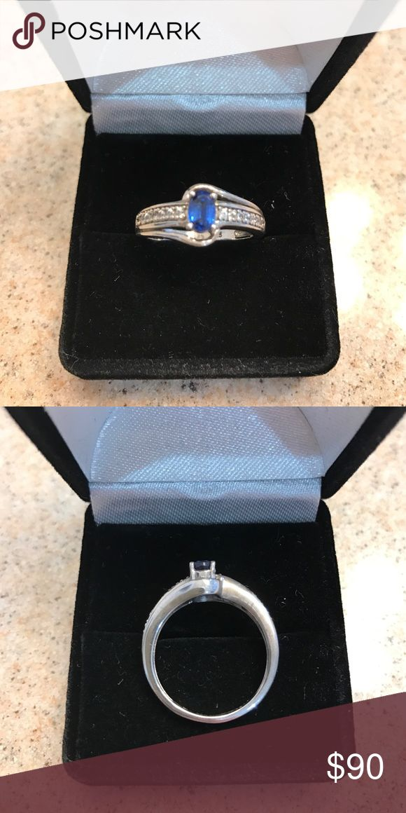 🔥Sterling Silver sapphire & white sapphire ring🔥 This is a Sterling Silver ring that has one oval blue sapphire and seven round white sapphires, size 6 1/2 Jewelry Rings
