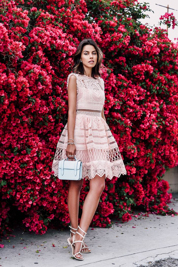 Perfect formal summer dress. Fit and flare pink lace dress paired with pink gladiator sandals and a light blue bag.