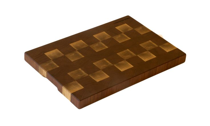 End grain Black Walnut cutting board made by Cherrywood Studio. This handmade cutting board features beautiful wood patterns and a silky smooth natural beeswax finish. $275 | LargeCuttingBoards.com
