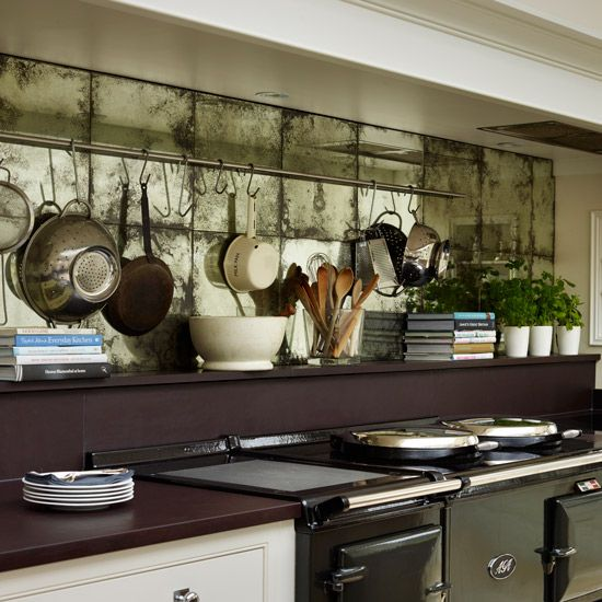 Shimmering tiles bring a touch of glamour to a country-style kitchen. Splashback by Martin Moore. #kitchens #kitchendesign. http://www.hglivingbeautifully.com/2015/02/27/splashback-ideas-for-stylish-kitchens/