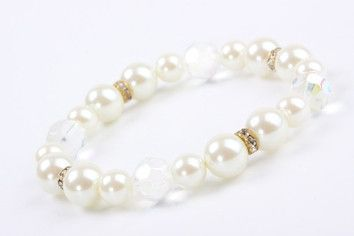 Pearls and Crystals Stretch Bracelet – Jewel Online Simulated Pearls and swarovski Crystals compliment each other for a feminine look. Elasticated to fit most. $55.00