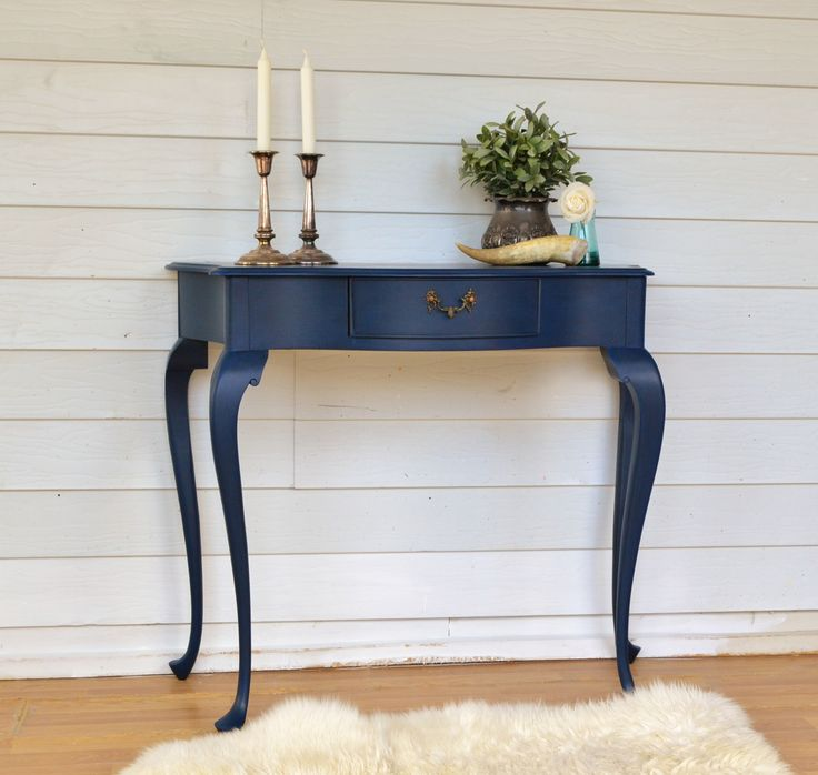 This vintage queen anne hall table with bow front has been painted in a deep intense sapphire blue, perfect statement piece for your entryway!
