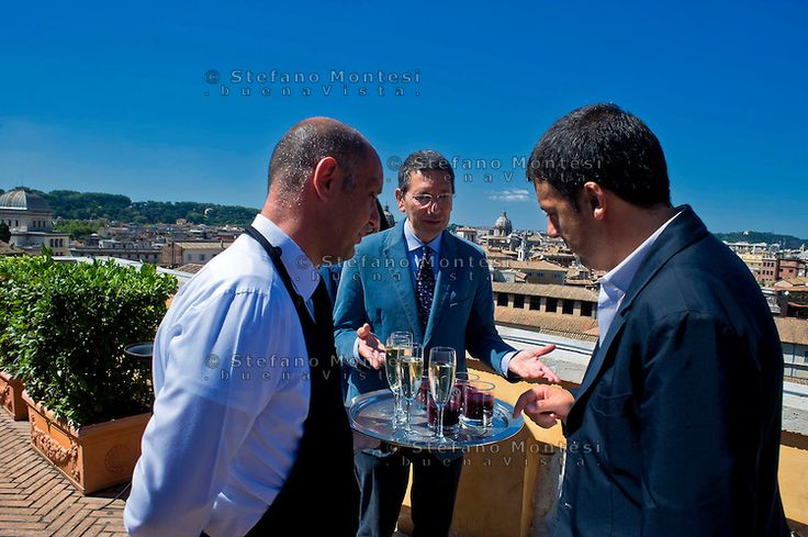 The meeting of the two mayors of Rome and Florence, Ignazio Marino and  Matteo Renzi, in Rome with a visit to the Roman Forum and the Capitoline Museums.A waiter serves drinks to the terrace Cafferelli