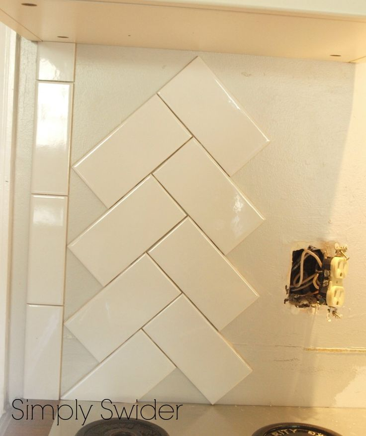 Subway Tile Back Splash in a Herringbone Pattern behind stove