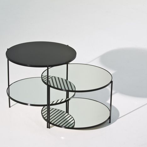 Moroso launch this set of low tables by Japanese designers Nendo, where a mirrored lower shelf reveals the patterned underside of the table top