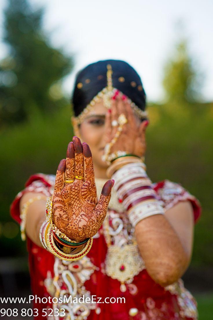 Henna Photo of Gujarati Bride in Gujarati Wedding in NJ. Getting Ready in Hilton Garden Inn, Rockaway, New Jersey. Wedding in Aashirwad Palalce. With Fellow Vendors - Rangoli Decorator, DJ Jay from Raaz Entertainment. Innovative photo of Mehndi .Featured in Knotsvilla.