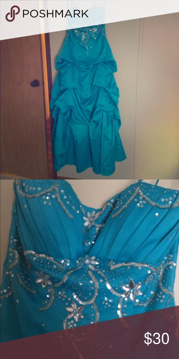 Strapless Turquoise Prom Dress Stunning strapless turquoise prom dress. Worn two or three times and has a few (very small) dirt marks at the bottom, but they would definitely wash out easily. This dress will absolutely make you feel like a princess! City Triangles Dresses Prom