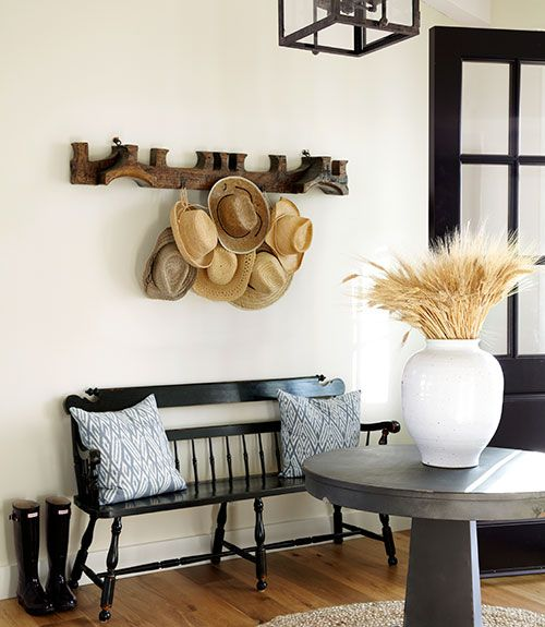Basic metal hooks turn an antique ox yoke into a hat rack in this California home.