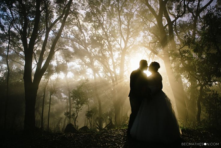 Silhouette wedding photography, golden hour, sun rays. Bride and groom. Romantic.  Photograph by www.becmatheson.com