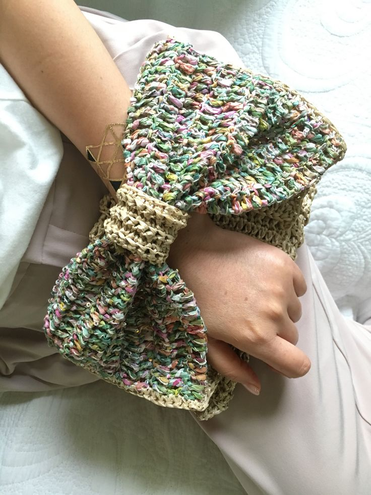crochet clutch bag with a sparkling ribbon