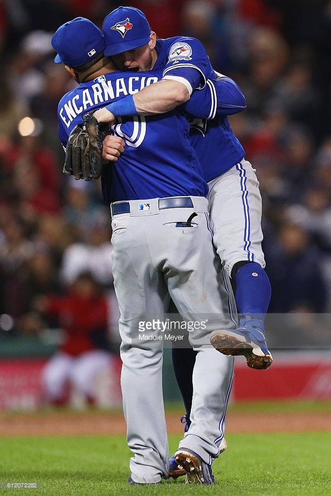 Josh Donaldson #20 of the Toronto Blue Jays and Edwin Encarnacion #10 celebrate their 2-1 win over the Boston Red Sox, clinching a Wildcard spot at Fenway Park on October 2, 2016 in Boston, Massachusetts.
