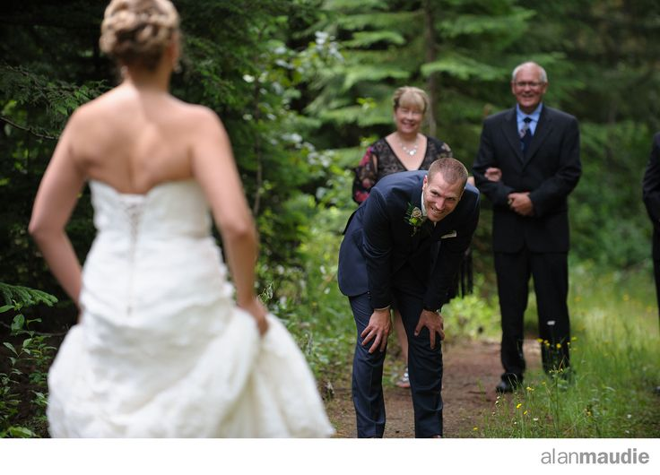 First look mountain wedding.  Awesome reaction! Heather Mountain Lodge wedding.  Golden, BC  rustic