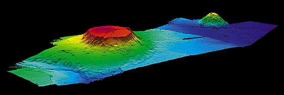 A guyot /ɡiːˈjoʊ/, also known as a tablemount, is an isolated underwater volcanic mountain (seamount), with a flat top over 200 metres (660 feet) below the surface of the sea. The diameters of these flat summits can exceed 10 km (6.2 mi)