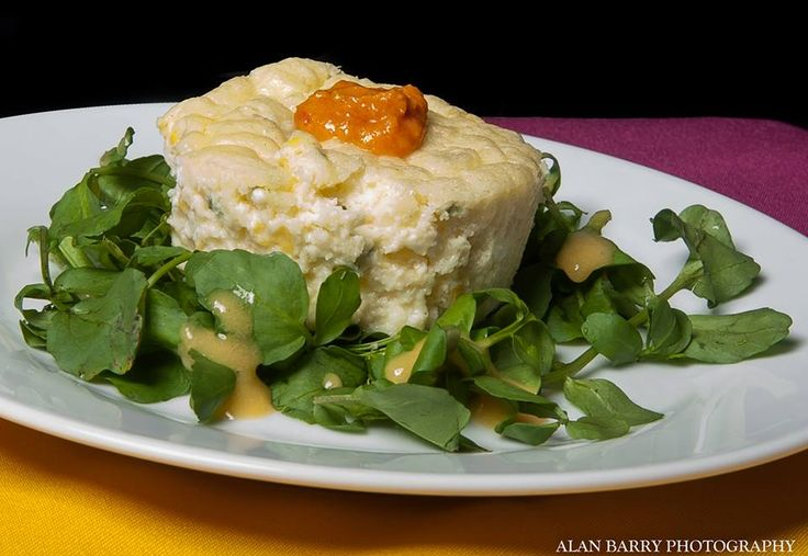 Sweet Corn Souffle with Cherry Tomato Compote on Wild Watercress with Summer Melon Drizzle