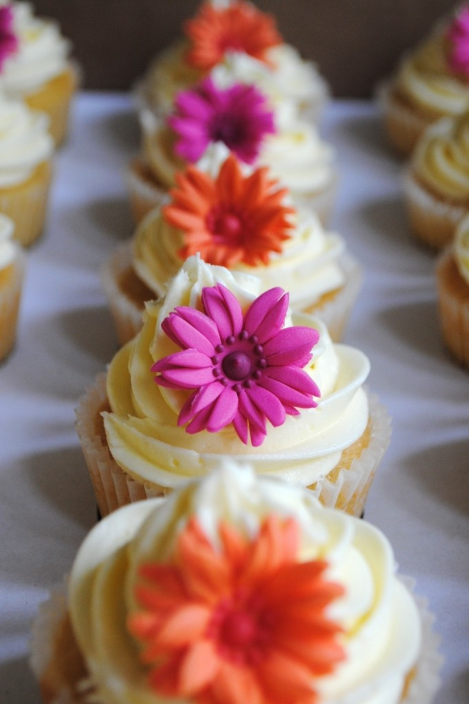 Mini sugar gerberas brighten any cupcake selection. But in pale pink xx