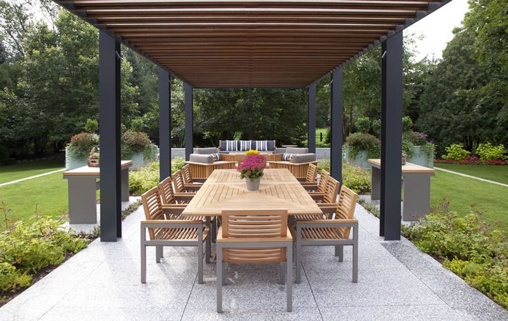 Contemporary pergola that covers this central outdoor eating area.