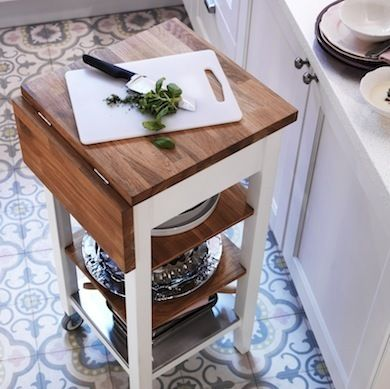Create a shelf/cart/bookcase next to the stove, then add a drop-down butter block on top