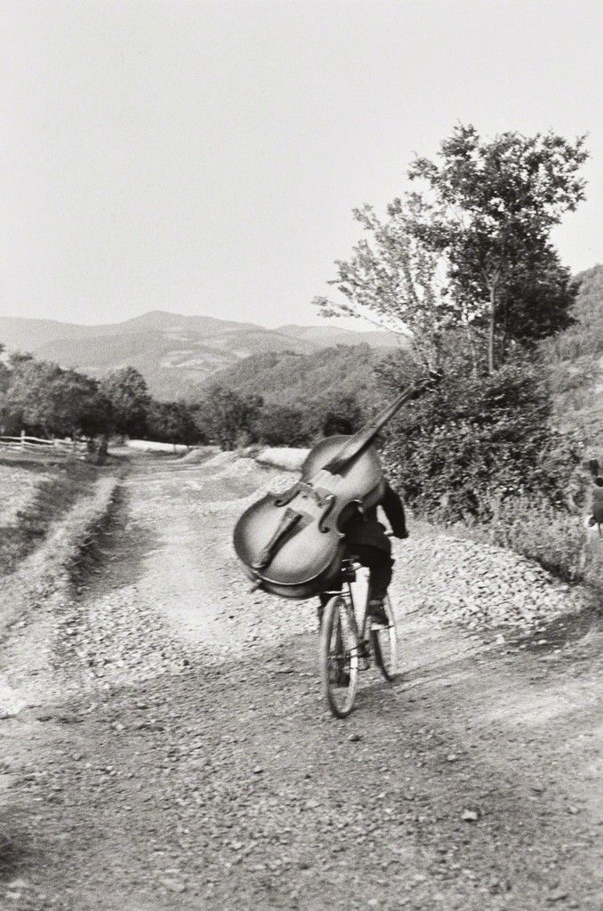 Henri Cartier-Bresson, Bass player on the road Belgrade-Kraljevo, to play at a village festival near Rudnik, Serbia, Yugoslavia, 1965, Phillips