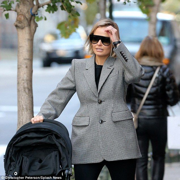 Flawless: The wife of Australian actor Sam Worthington showed off a golden glow on the day...