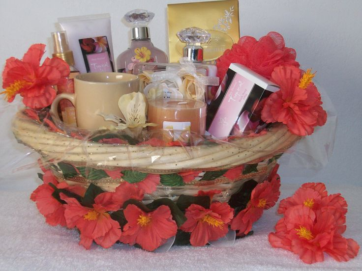 Vera Mae Gift Basket Collection Tropical Spa Basket Indulge in paradise you will feel like you have gone on a retreat! with body spray, body lotion, body sponge, shower gel, hand lotion, cleansing body bar, candle, soap rose petals, cup, lindt lindor truffles chocolate mix with milk, white, dark, and with our one of a kind finest decorative design basket just for you. Vera-Mae Collection (This Item Is Sold)