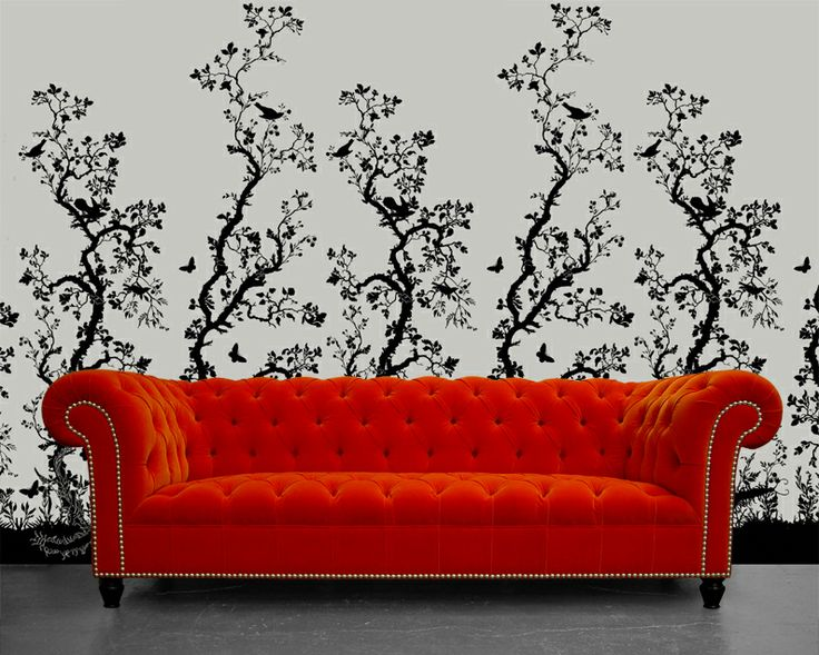 Rume | Beautiful English furniture, beautifully made.  Our Orange Chesterfield Smithfield sofa sits on a backdrop on the beautiful @June Kuiper Doubt Beasties Studio Birdbranch Wall covering available here - http://www.timorousbeasties.com/shop/wallcoverings/33/birdbranch-hand-print/
