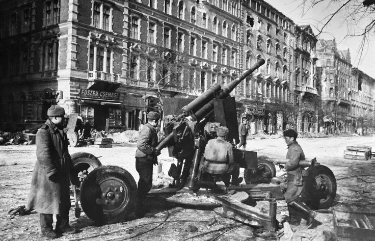 A Soviet 85-mm anti-aircraft gun 52-K (Mod 1939) in the streets of Budapest, 1945. The Red Army routinely deployed AA guns in street fighting often firing them over open sights down straight avenues. This crew is preparing to fire but the surroundings seem too peaceful leading to the thought that this was a posed propaganda photo.