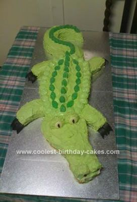 Homemade Crocodile Birthday Cake: After lots of looking to get inspiration, of both real crocs and other croc cakes, I made a template from baking paper and worked out how many cakes, and