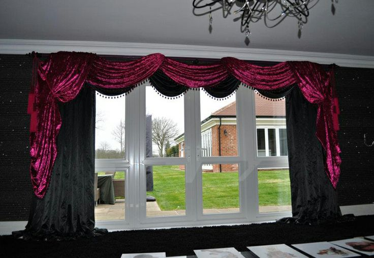 Silk interlined curtains with swags trimmed in designer guild ball balls. Contrasted with velvet over swags and tails which are tied with tassels Made by Teresa
