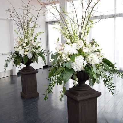 Haute Flower Boutique Laurie Schneider Photography - urns with white and green flowers