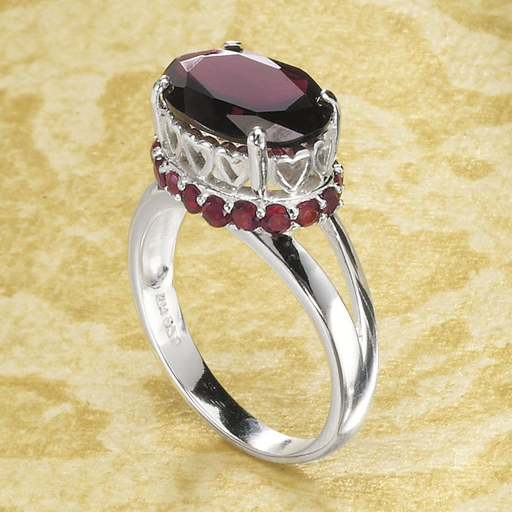 Garnets Galore. An array of gorgeous, genuine garnets-gemstones of fidelity and commitment-glow in the 8-ct. cabochon and faceted accents of this heart-surrounded setting of polished sterling silver.