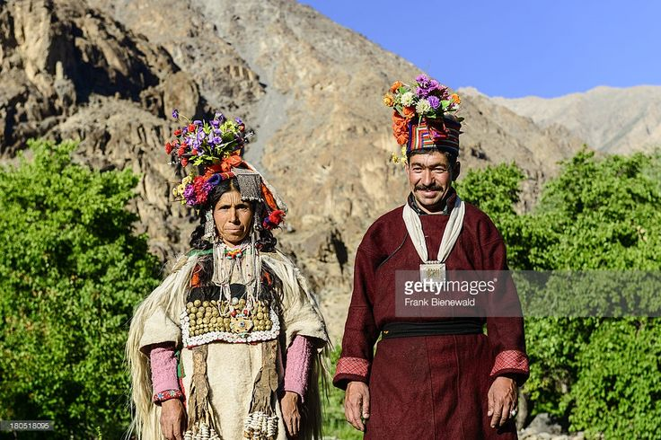 A couple of the Brokpa tribe, an arien race, who migrated to India from Persia, are wearing their traditional dresses. The main feature is a flower arrangement carried on the head..