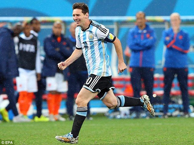 Lionel Messi runs away in celebration after Argentina reach the World Cup final... http://www.dailymail.co.uk/sport/worldcup2014/article-2686723/Lionel-Messis-girlfriend-Antonella-Roccuzzo-joins-fellow-wags-cheer-Argentina-way-World-Cup-final.html
