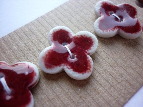 £7 for 3 porcelain buttons. Susansharpeceramics on etsy: Red Buttons, Buttons Peaches, Porcelain Quatrefoil, Porcelain Buttons, Red Porcelain, Peaches Bloom, Bloom Red, Quatrefoil Buttons, Ceramics Buttons