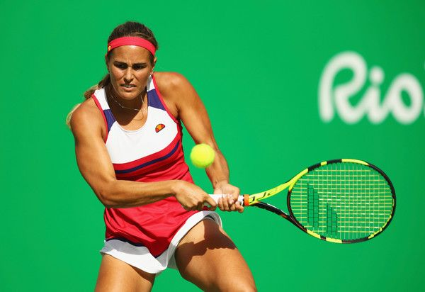 Monica Puig Photos - Monica Puig of Puerto Rico returns a backhand against Petra Kvitova of the Czech Republic during the Women's Singles Semifinal on Day 7 of the Rio 2016 Olympic Games at the Olympic Tennis Centre on August 12, 2016 in Rio de Janeiro, Brazil. - Tennis - Olympics: Day 7