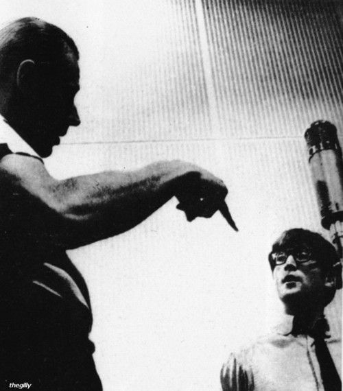 "John at EMI Studios, 11 September 1963. Photo by Robert Freeman -- Producer, George Martin (the true ""5th Beatle"" ) is talking music w/Lennon. G.Martin played piano on certain songs, and he arranged the strings etc... the horns on Day in a Life, the strings on Eleanor Rigby, and ANYTHING in that regard, more than a producer - this day &age, he would be a co-writer for sure."