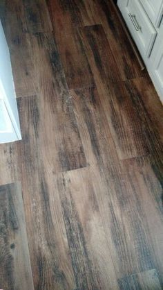Vinyl peel and stick wood flooring for our travel trailer, rv camper make over. So cheap from lowes and modern.