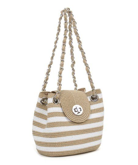 Boasting bold stripes and a boho woven-straw design, this compact bag artfully combines form and function.
