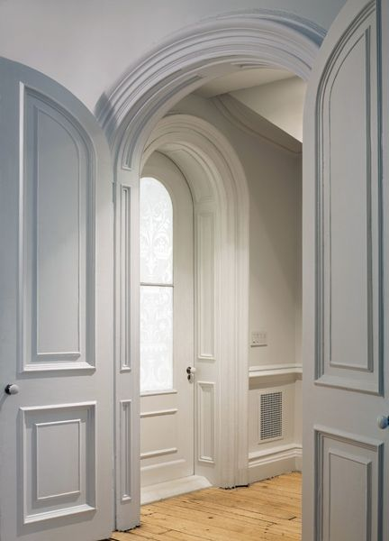 "NYC Victorian townhouse renovation: Although the detail throughout is streamlined & minimalist, there is a wealth of attention paid to it. ""There was an overall attempt to eschew the hard-edged modernism, which tends to be a little masculine,"" says the architect, ""& rather embrace the sensual curves of the Victorian moulding."" - Photography by Bruce Buck"