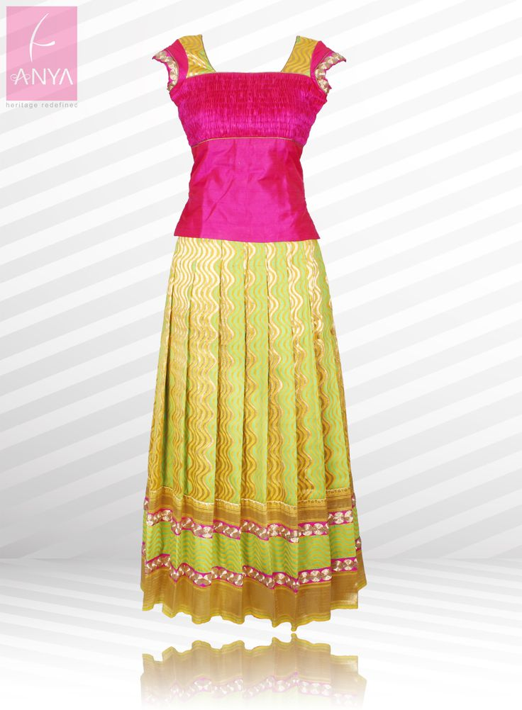 Drees up in style in this beautiful pink and green pattu pavadai highlighted with borders and laces.