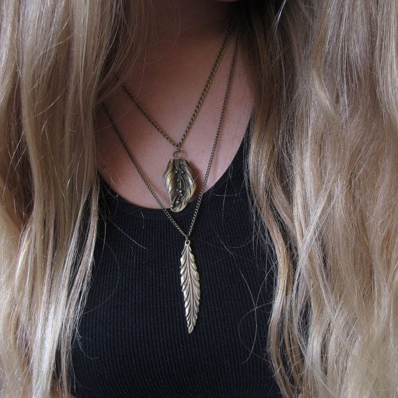 This is a very unique layered statement piece that is trending in the fashion world today!  Made with antique bronze leaf charms this
