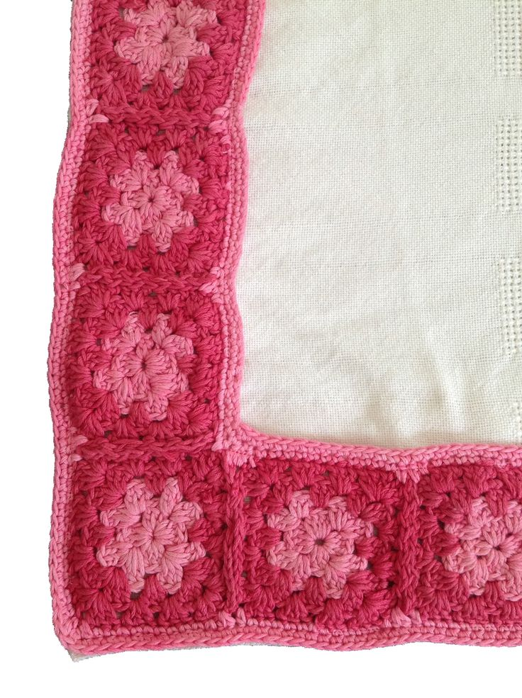 Organic cotton blanket in cream with a hand crochet border in pink and raspberry