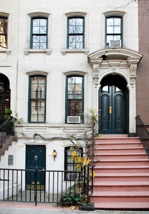 Beautiful townhouse. Love the doors and the pretty stairs.