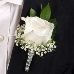 Groomsmen's boutonniere - this with a peacock feather behind it.