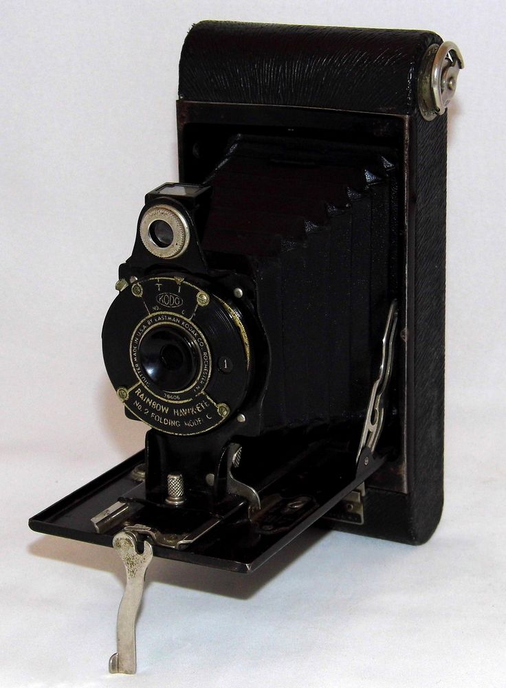 https://flic.kr/p/Wo5ZRb | Vintage Kodak Rainbow Hawk-Eye Folding Camera, No. 2 Model C, Made In USA, Circa 1930 | From a 1930 newspaper ad for the Kodak Rainbow camera -- Well-named are these new Rainbow Hawk-Eyes - bright, cheerful Eastman-made cameras that come in coverings as subtly tinted as the rainbow itself. Vermillion to blue, light green to dark maroon-whatever your favorite shade may be, you'll find it here in a Rainbow Hawk-Eye.  Of course, the Rainbow Hawk-Eye also came in black…