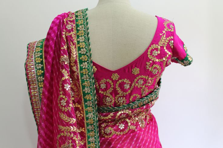 Fushcia Pink pure chiffon Lehariya saree with Gota patti work. It comes with a fushcia pink pure crepe unstitched blouse with gota work all over. To buy this saree drop a message.